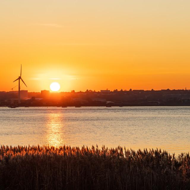 """Sun setting over Slade Green near dartford along the Thames Estuary, Kent..."" stock image"
