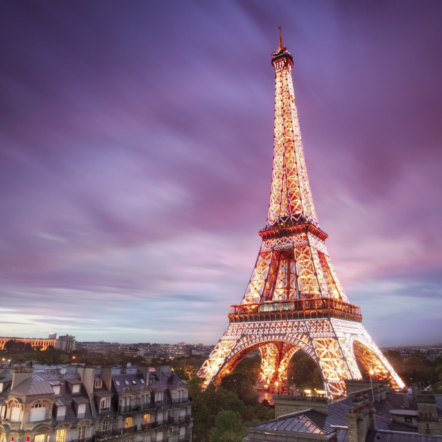 """""""High view of lower section of Eiffel Tower at dusk"""" stock image"""