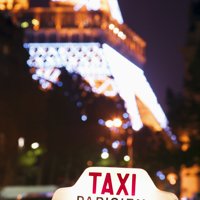 """""""Eiffel tower and Taxi cab at night"""" stock image"""