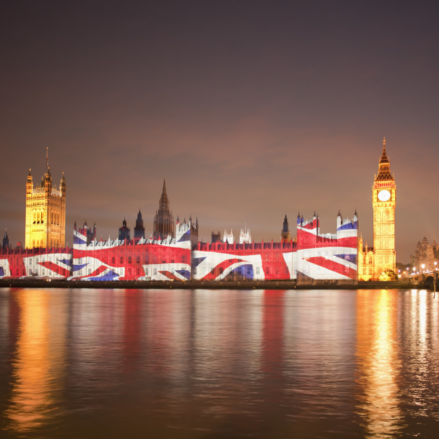 """""""Union Jack Flag projected onto the Houses of Parliament at dusk"""" stock image"""