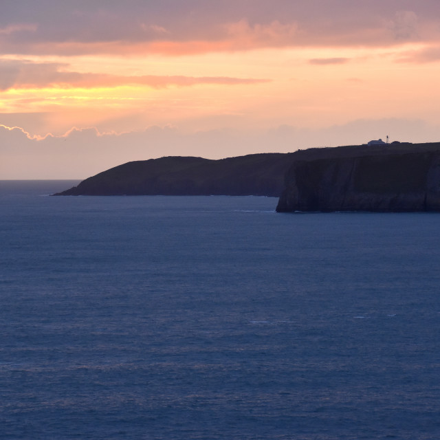"""""""Sunset over Lydstep point in Pembrokeshire"""" stock image"""