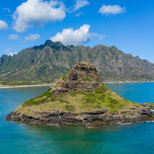 """""""Aerial view of chinamans hat by Kualoa regional park with mountains in..."""" stock image"""