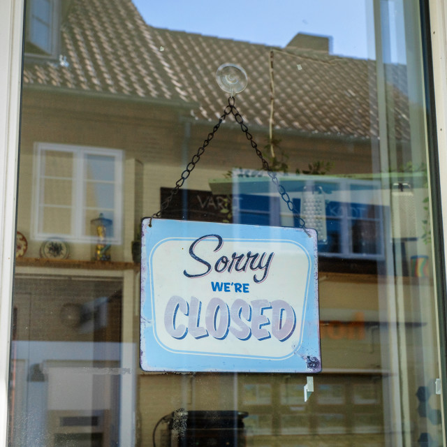 """""""Closed sign hanging in a store window"""" stock image"""