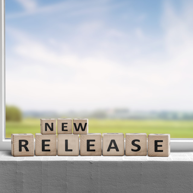"""""""New release sign in a window on a sill"""" stock image"""