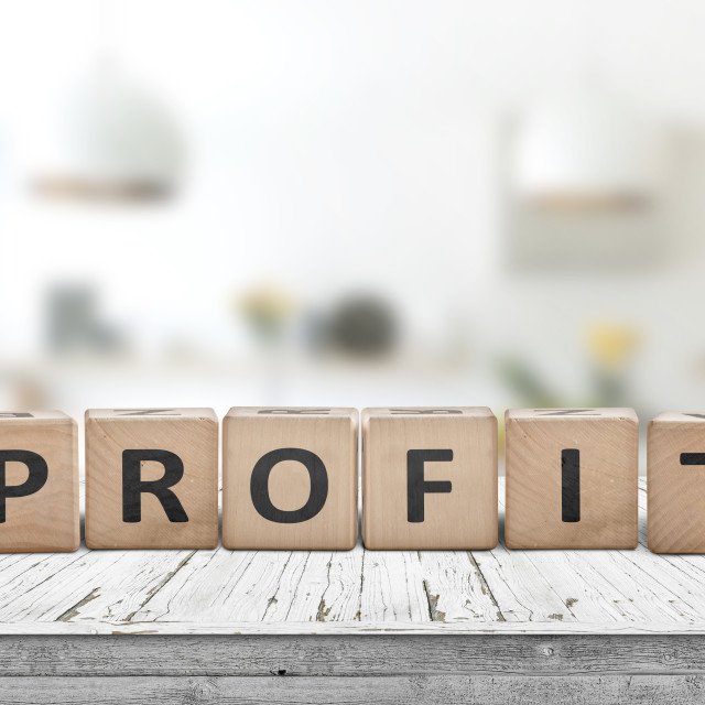 """""""Profit sign in a bright room on a wooden table"""" stock image"""