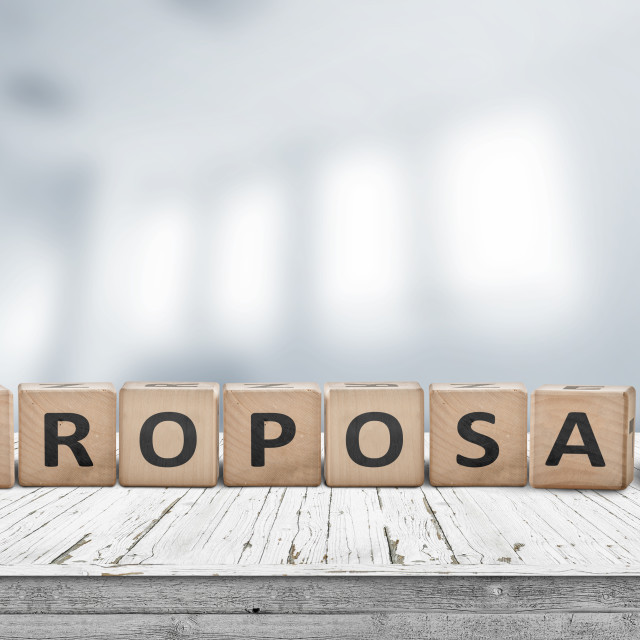 """""""Proposal sign on a wooden desk in a bright office"""" stock image"""