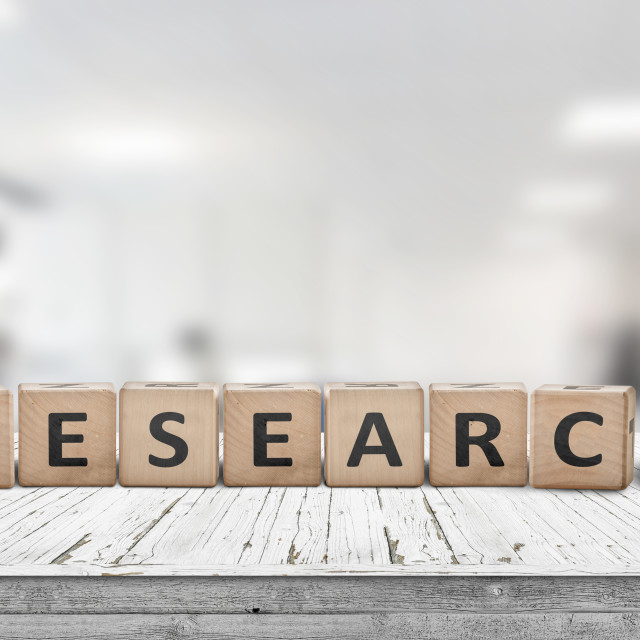 """""""Research sign on a desk made of wood"""" stock image"""