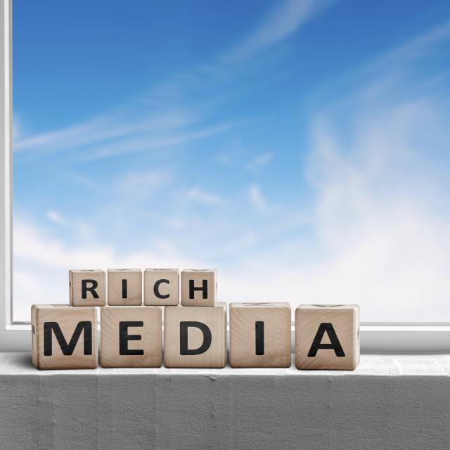 """Rich media sign written on wooden blocks"" stock image"
