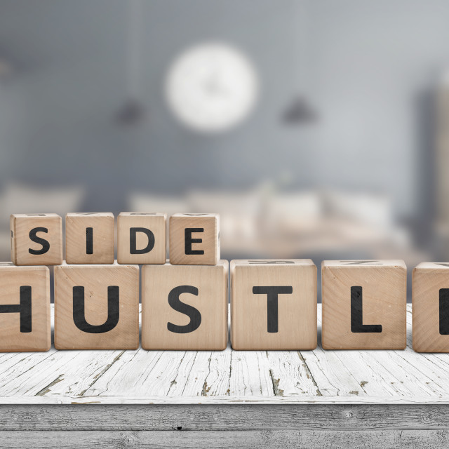"""""""Side hustle sign on a plank table"""" stock image"""