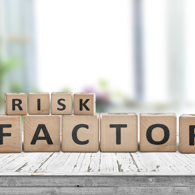 """""""Risk factor sign on a wooden table"""" stock image"""