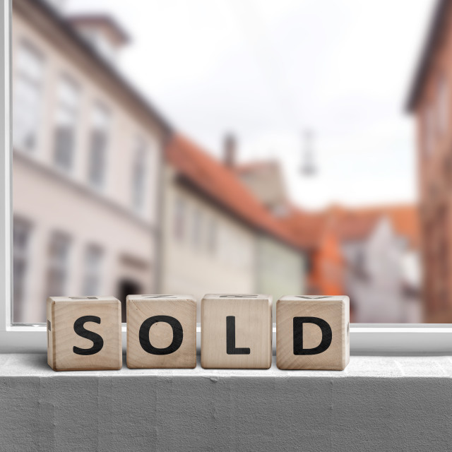 """""""Sold word made with cubes in a window"""" stock image"""