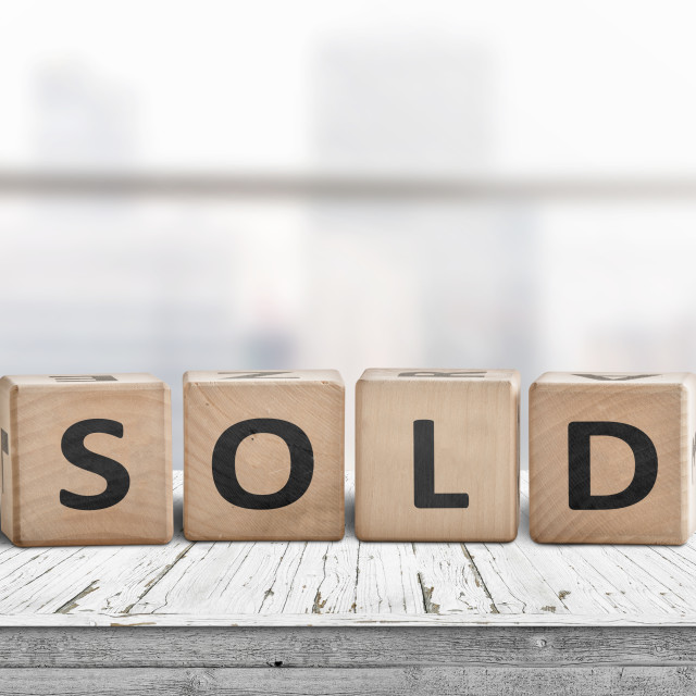 """""""Sold sign on a wooden table"""" stock image"""