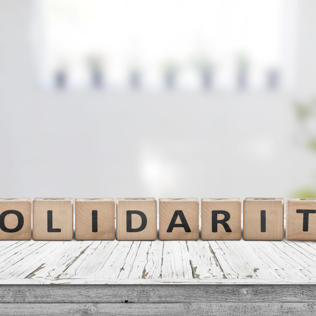"""""""Solidarity message on a wooden table"""" stock image"""