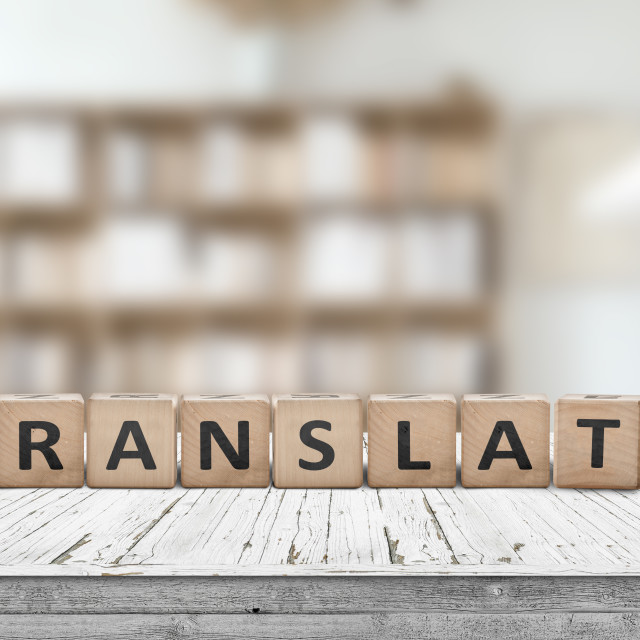 """""""Translate message on a desk in a bright living room"""" stock image"""