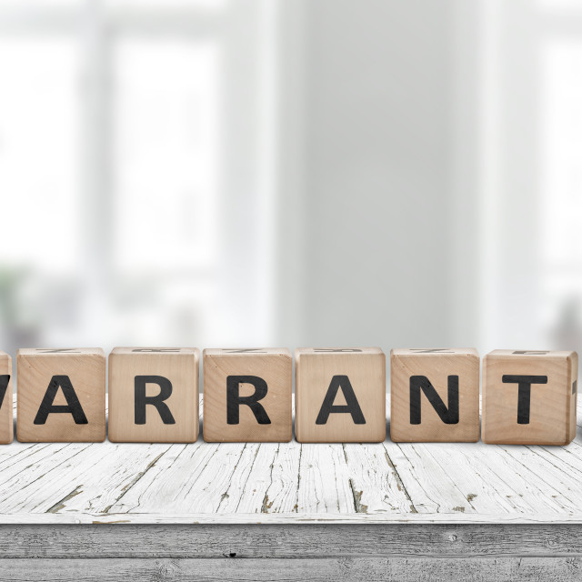 """""""Warranty sign on a wooden desk"""" stock image"""