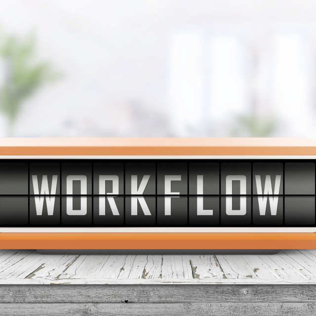 """""""Workflow alarm message on a wooden desk"""" stock image"""