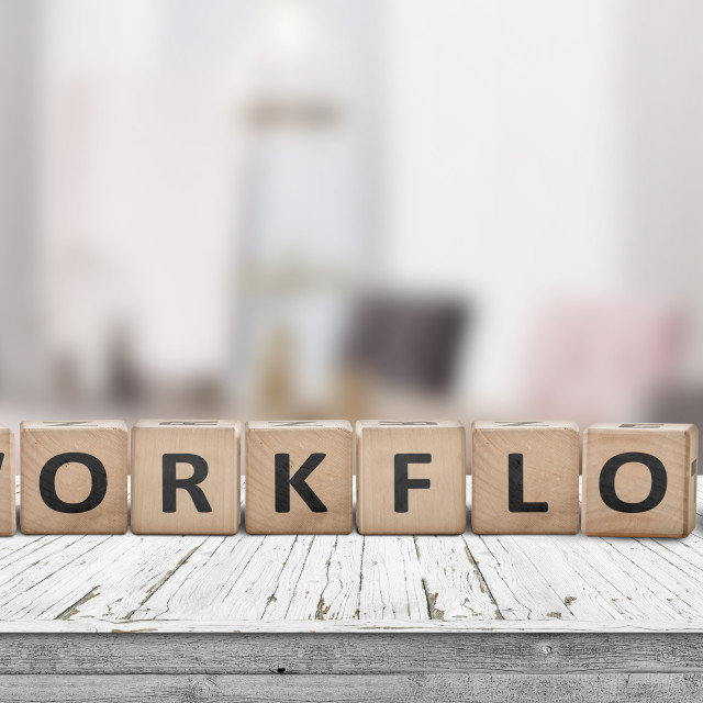 """""""Workflow sign in a bright office on a wooden desk"""" stock image"""