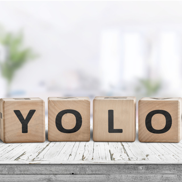 """""""Yolo abbreviation sign in a bright living room"""" stock image"""