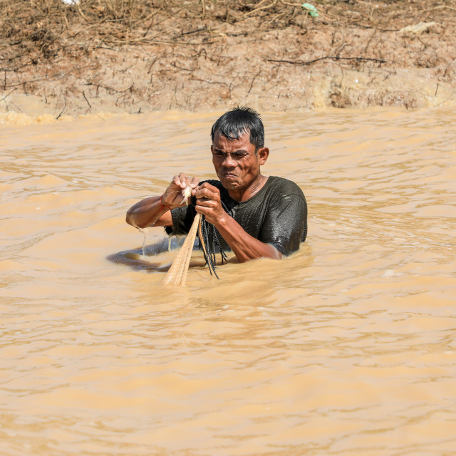 """Fisherman, Tonlé Sap Lake, Cambodia"" stock image"