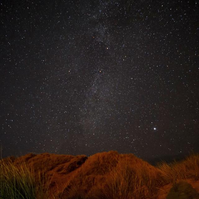 """Night sky over Holywell Bay."" stock image"