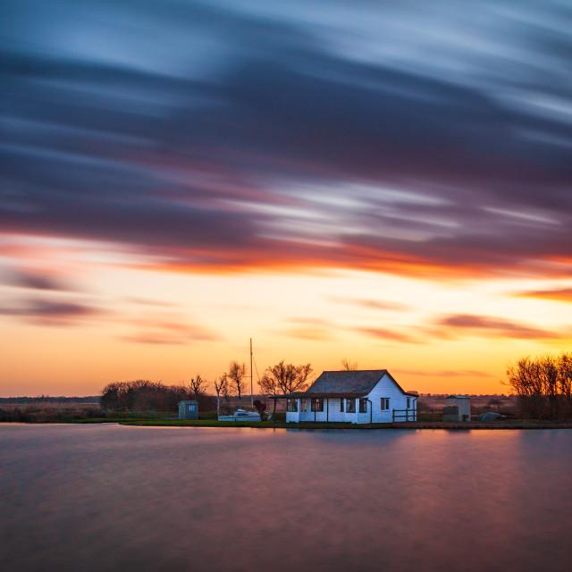 """Sunset colour over St Benets Windpump"" stock image"