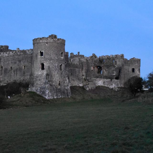"""Blue light over Carew Castle"" stock image"