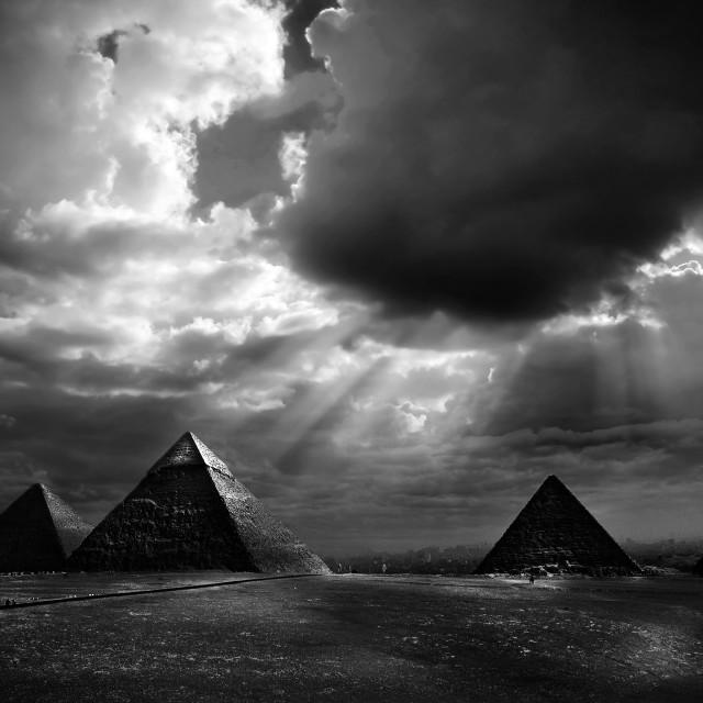 """Sun rays over Pyramids of Giza"" stock image"