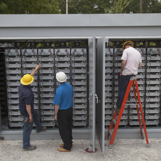 """""""Tradesmen working on electrical components outside"""" stock image"""