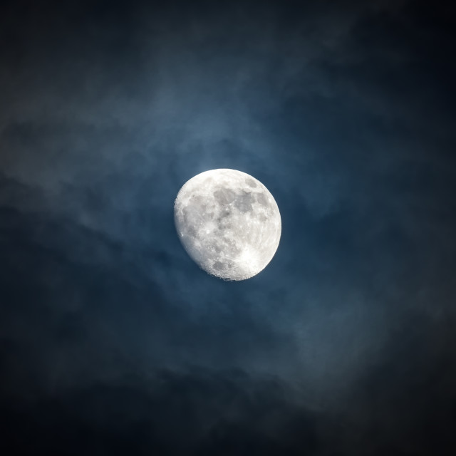 """""""Waxing moon encircled by clouds"""" stock image"""