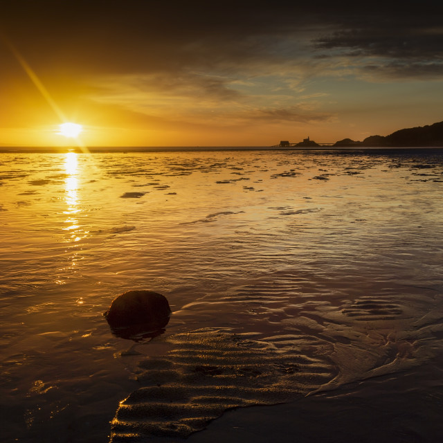 """Sunrise at Swansea Bay"" stock image"
