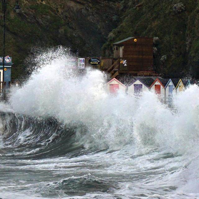 """Storm Ciara Beach Huts."" stock image"