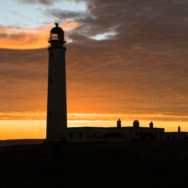 """Sunrise and the Lighthouse"" stock image"