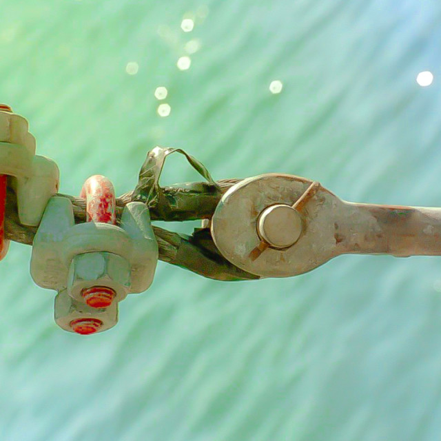 """""""Bolt, clamps and cable on a fishing boat"""" stock image"""