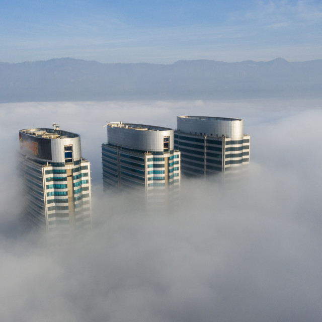 """""""City Under Clouds and Fog"""" stock image"""