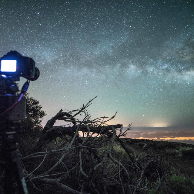 """Camera taking a picture of the milky way"" stock image"