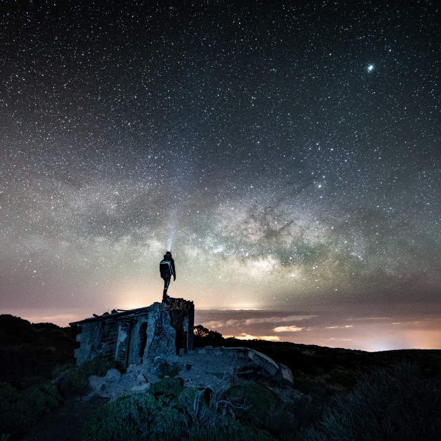 """Man gazing at the milky way"" stock image"