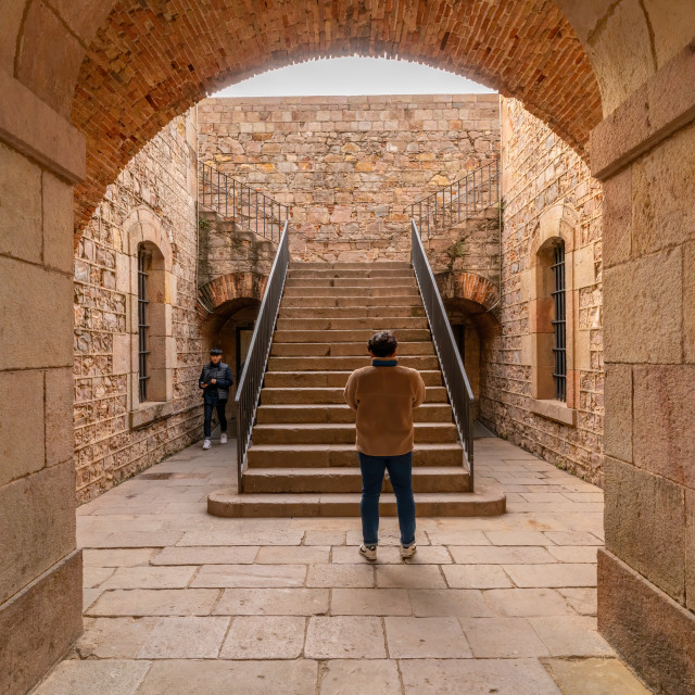 """Barcelona, Spain - January 27 2018 : A man stands at steps leading to the..."" stock image"