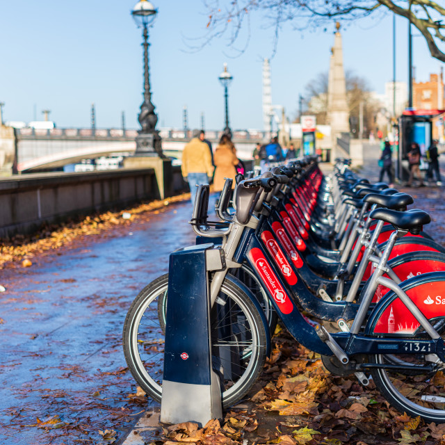 """London, England - November 29 2019 : Santander rental bikes lined up on..."" stock image"