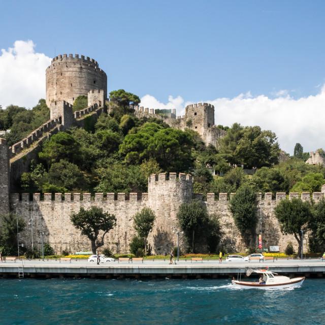 """A boat sails past the Rumelian Castle"" stock image"