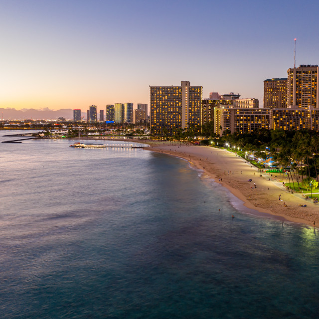 """Aerial view of Waikiki beach towards Honolulu at sunset"" stock image"