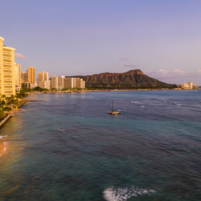 """Aerial view of Waikiki beach towards Diamond Head at sunset"" stock image"