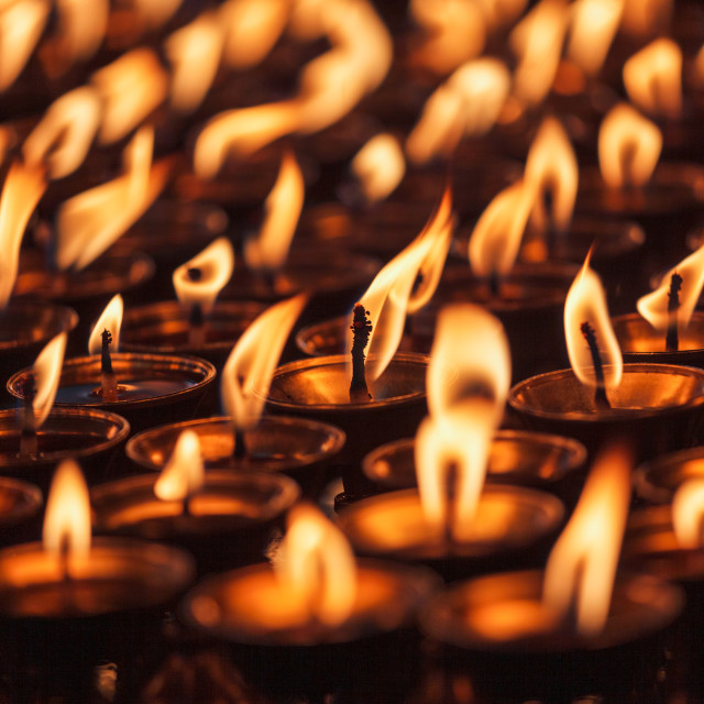"""Burning candles in Buddhist temple"" stock image"