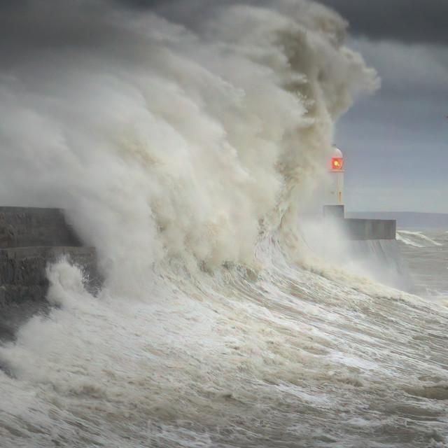 """Storm Ciara hits Porthcawl lighthouse"" stock image"