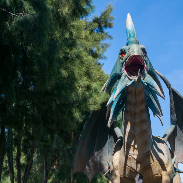 """Blue angry dragon at the entrance of the Zoomarine Park"" stock image"