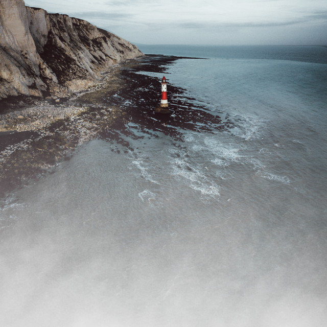 """Low Tide at Beachy Head Lighthouse in Eastbourne, East Sussex"" stock image"