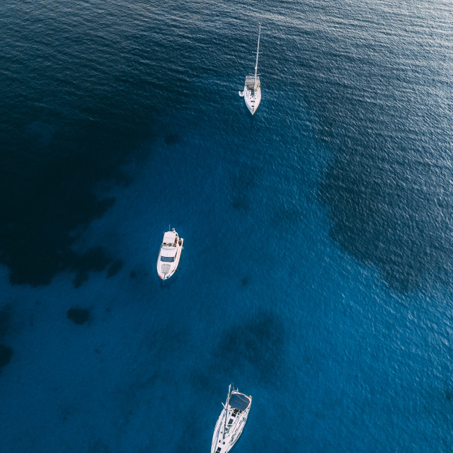"""Three white boats sailing in the open ocean - crystal clear blue water. Thasos Island - Greece, Europe"" stock image"