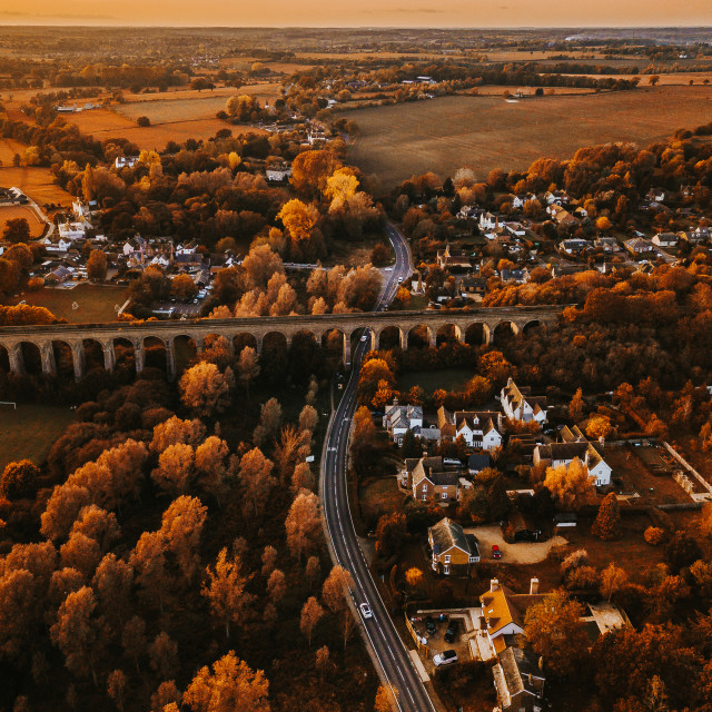 """Train Viaduct over a village in the heart of Essex, Colchester, United Kingdom"" stock image"