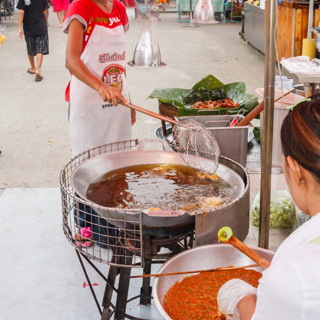 """Woman vendor stir frying food"" stock image"