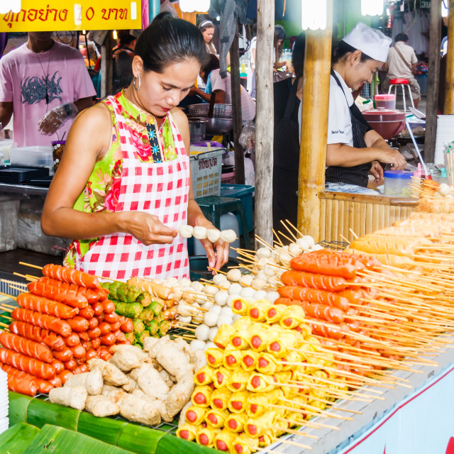"""""""Woman vendor selling skewered food"""" stock image"""