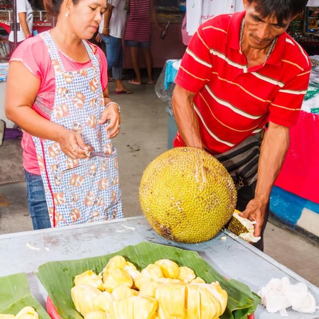 """Vendor selling preparing Durian fruit for sale"" stock image"